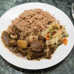 Curry-Goat-Served-with-Plantin-Emmanuel Caribbean Takeaway