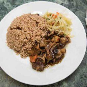 Oxtail-Served-with-Plain-Ri ceEmmanuel Caribbean Takeaway